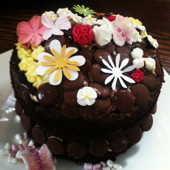 Outstanding Katies 20Th Birthday Cake Chocolate Fudge With Icing Flowers Personalised Birthday Cards Veneteletsinfo